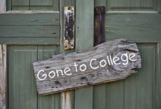 Old gone to college sign on doorway.